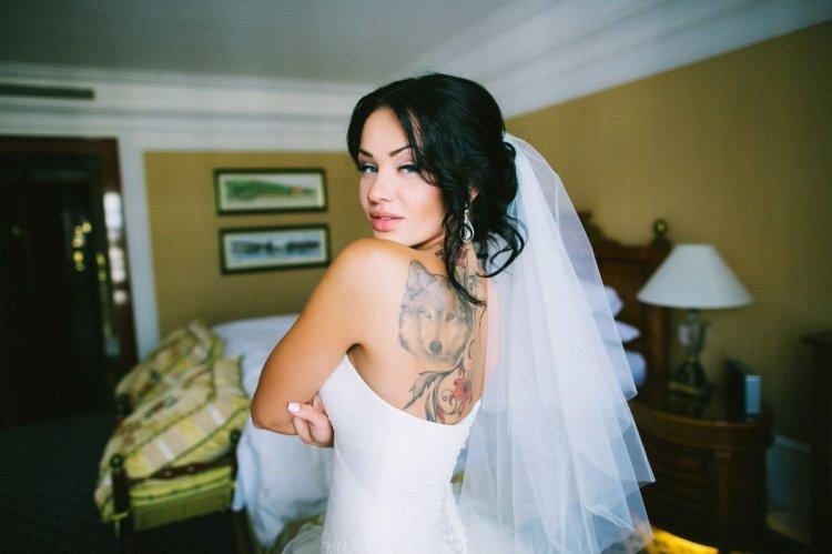 Tattoo on the back of the bride