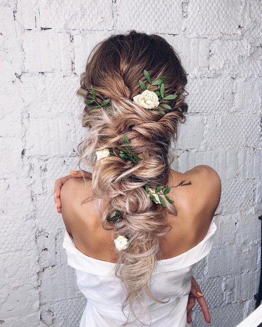 Delicate hairstyle with complex braiding